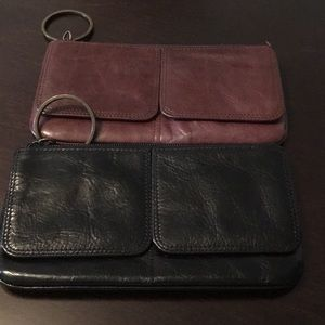 Two (2) leather wallets